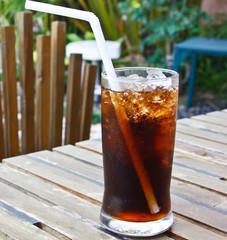 Fresh cola drink on wood table