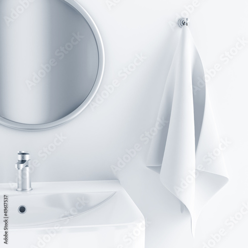 bathroom interior with a sink and mirror and towel