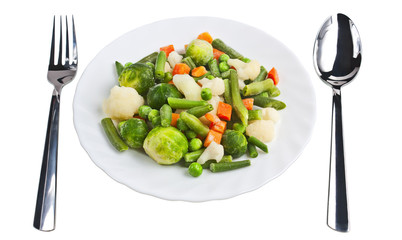 Sliced ​​vegetables on a plate isolated