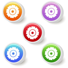 Five colorful gear buttons