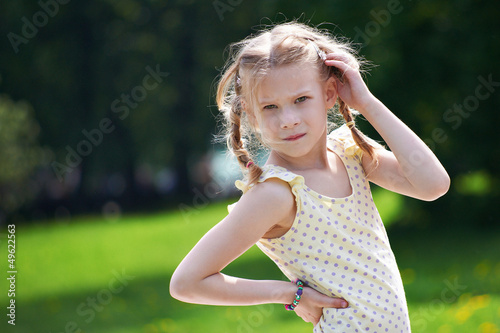 Portrait of young girl on summer sunny landscape