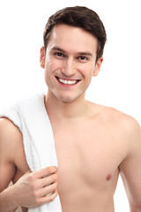 Smiling man with towel