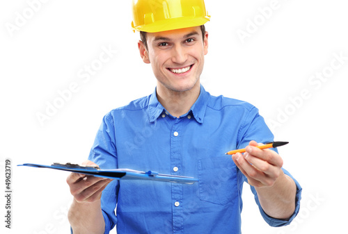 Engineer with pen and clipboard