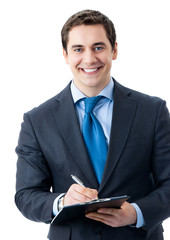 Cherrful businessman with clipboard writing