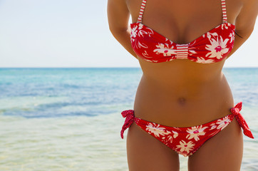 woman in a red bathing suit on the beach