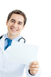 Portrait of smiling doctor with signboard, isolated