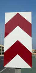 Chevron road sign