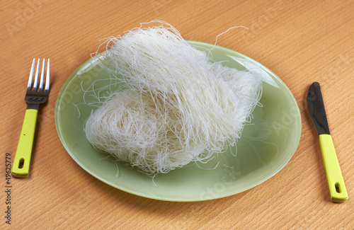 Raw rice noodles in green