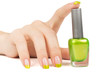 woman's hand with a bottle of green nail polish