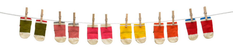 Colorful baby socks on clothesline isolated on white background
