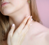 Unrecognizable female person apply cosmetic cream on her neck poster