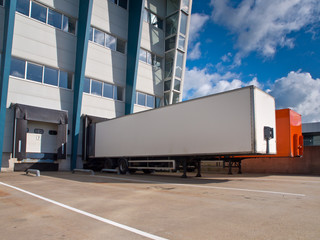 Distribution Center Loading Docks with Cargo Trailers