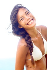 Happy people - joyful smiling woman in bikini