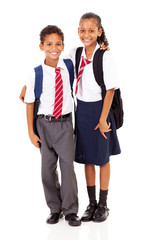 two elementary school students full length isolated on white