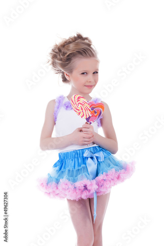 Smiling girl with caramel posing in studio