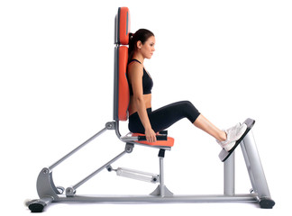 Slim brunette on modern isodynamic trainer