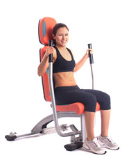 athletic woman on modern gym trainer