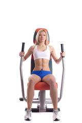 athletic blonde on modern gym equipment