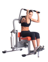 sporty woman doing exercises on gym equipment