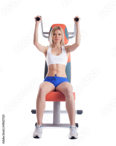 Beautiful blonde on power exerciser