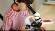 Young boy with microscope