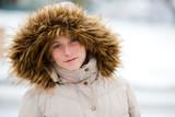 Beautiful teen girl in snow