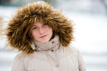 Beautiful teen girl in snow