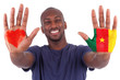 African man hands with a painted heart and cameroon flag, i love