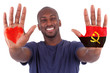 African man hands with a painted heart and angolan flag, i love