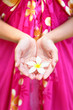 Hawaiian flower in cupped hands