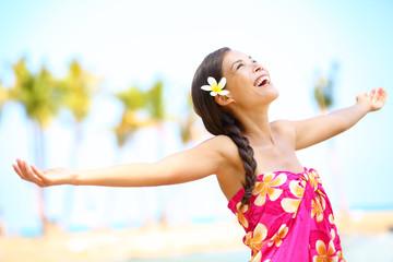 Free happy elated beach woman in freedom joy concept
