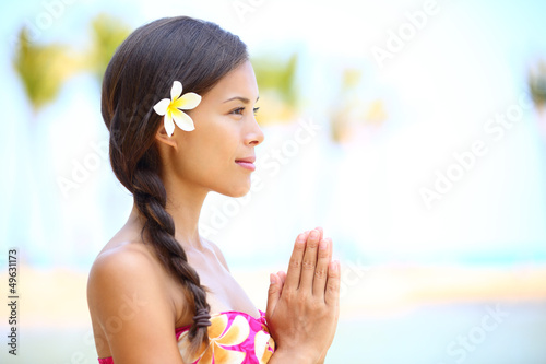 Serene meditation - meditating woman on beach
