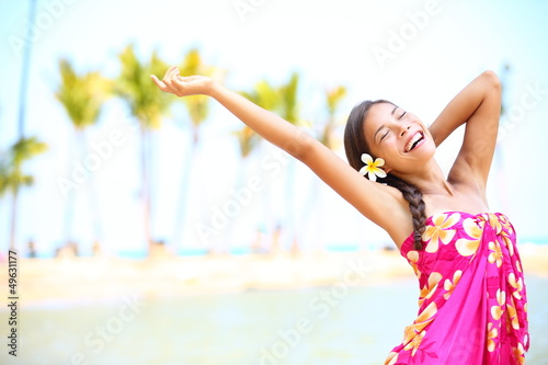 Happy people on beach travel - woman in sarong