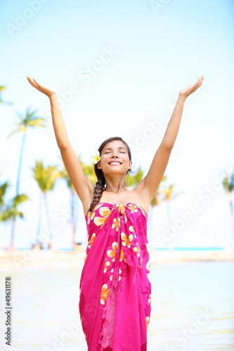 Free spiritual woman on hawaii on beach