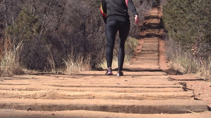 Woman walking up the Manitou Incline in Colorado