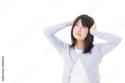 a worred young asian woman on white background