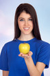 Teenager girl with a yellow apple