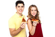 Young lovers posing with pizza slice in hand