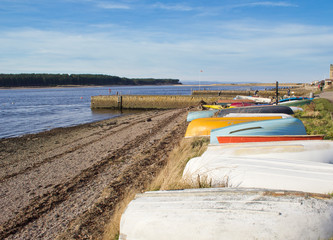 Row of upturned boats on Findhorn beach, Scotland