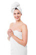 Hot woman in bath towel smiling at you