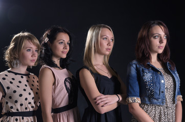 Four attractive women standing in a row