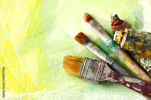 Artists brushes on an abstract artistic background