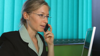 Happy business woman talk a mobilephone