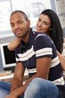 Attractive interracial couple smiling at home