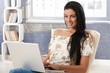 Attractive female with laptop computer smiling