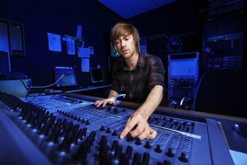 Man using a Sound Mixing Desk