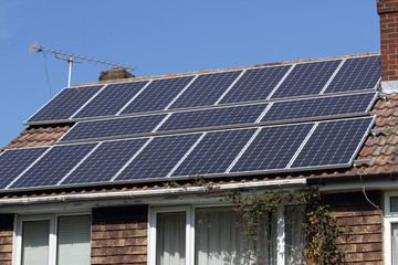 Solar photovoltaic panel array on house roof