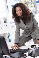 Attractive businesswoman working at desk smiling