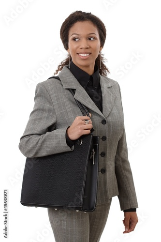Pretty businesswoman going to work smiling