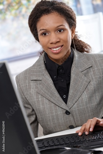 Ethnic businesswoman working with computer